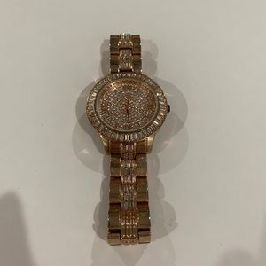 Rhinestone gold tone watch. Needs battery.